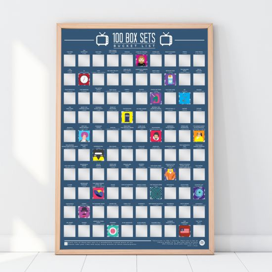 100 Box Sets Bucket List Scratch Poster leaning against a white wall with some squares scratched away showing the image