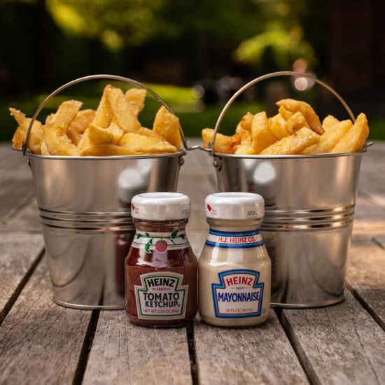 Treat Factory Gastro Pub Chip Buckets with two mini sauce bottles on a wooden bench