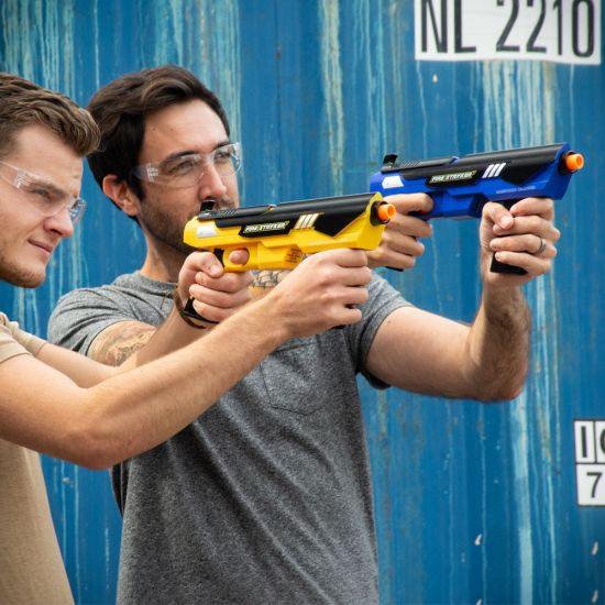 two men taking aim with Fire Stryker Paintball Blaster Twin Pack