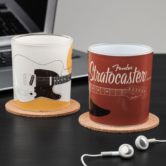 Fender Drinking Glasses  on two coaster in front of a pair of headphones