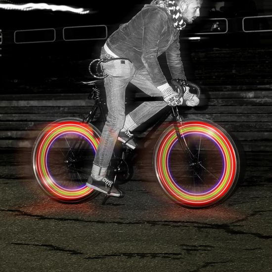Bike Wheel LED Lights with 7 Flashing Settings display coloured lines on a fast moving bike
