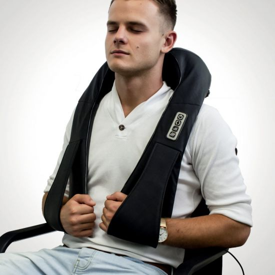 Shiatsu Neck Massager with Arm Loops worn by a man on a grey background