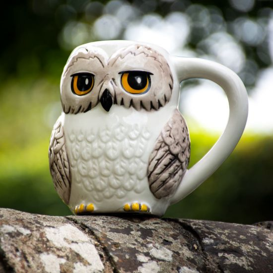 Officially Licensed Harry Potter 3D Hedwig Mug sat on a stone wall