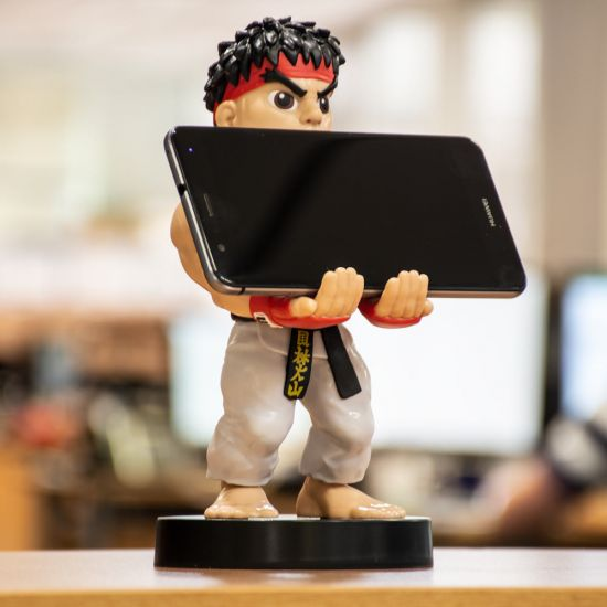 """Street Fighter Ryu 8"""" Cable Guy holding a phone in the office"""