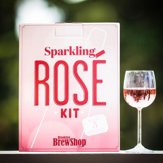 Brooklyn BrewShop Sparkling Rosé Kit in a garden with a glass of wine