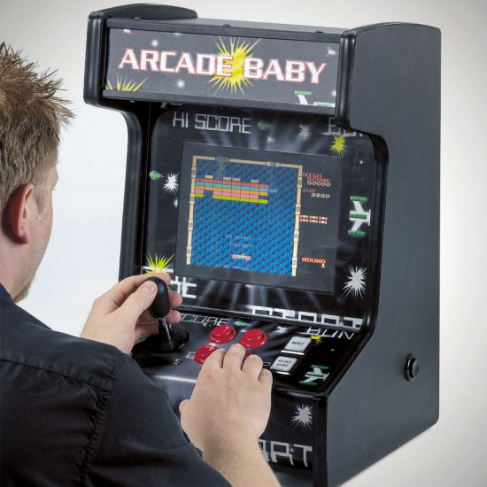 Mightymast Arcade Baby with a man playing