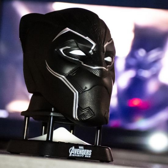 Avengers Black Panther Bluetooth Speaker with black panther film in the background