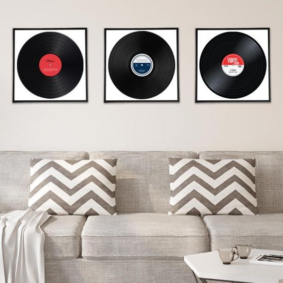 "set of three 12"" record frames on lounge wall above sofa"