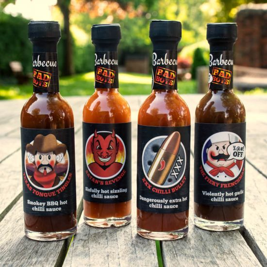 Barbecue Bad Boys Sauce Selection – 4 Hot Sauces on a wooden bench