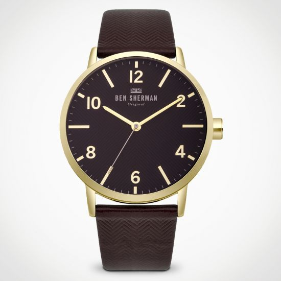 Ben Sherman Big Portobello Herringbone WB070RB Watch with brown strap and gold case on a grey background facing the camera