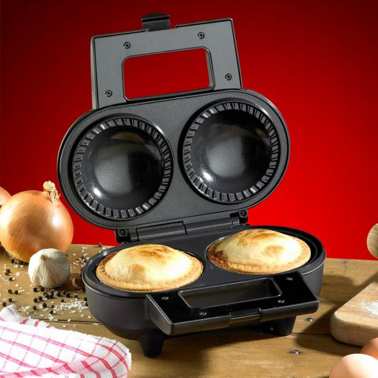 Hairy Bikers Double Deep Fill Pie Maker on a chopping board with two freshly baked pies inside
