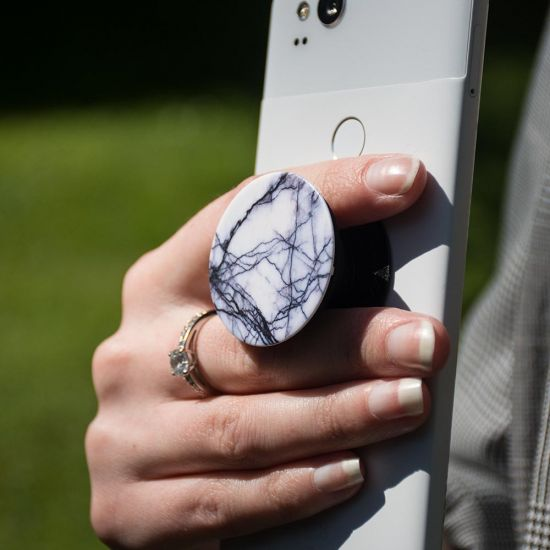 Popsocket Marble on a white phone