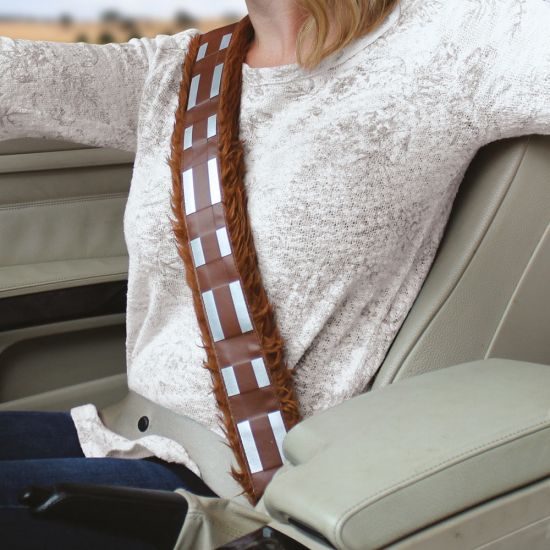 A woman drives her car wearing a Chewbacca seat belt cover
