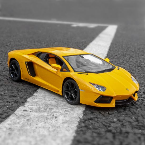 Yellow Lamborghini Aventador Coupe on tarmac