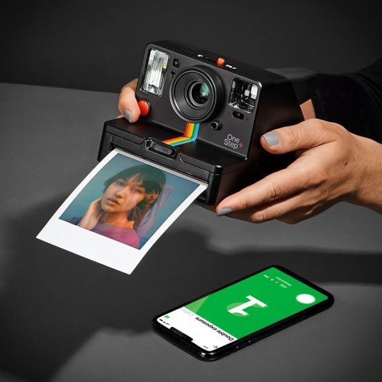 Polaroid OneStep+ with cool developed picture and phone with the Polaroid app