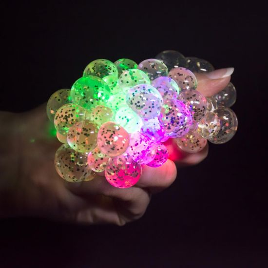 Light-Up Squashy Stress Ball squashed in a hand