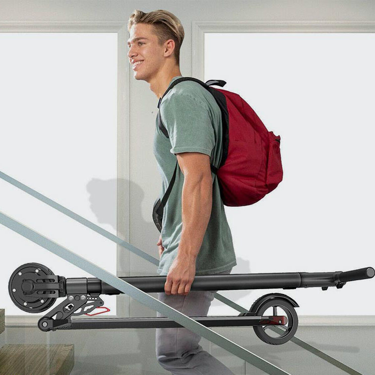man carrying folding electric scooter up stairs