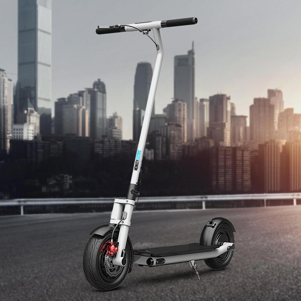 monkeylectric s17 white electric scooter with city in background