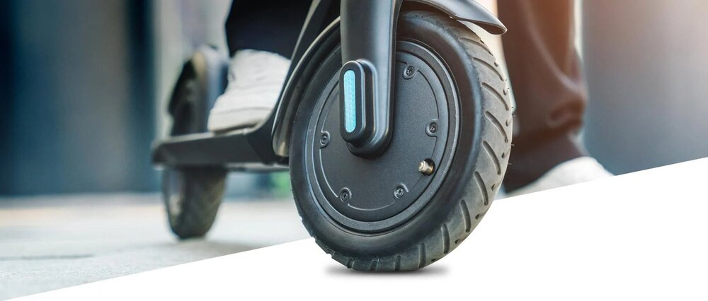 electric scooter with riders foot